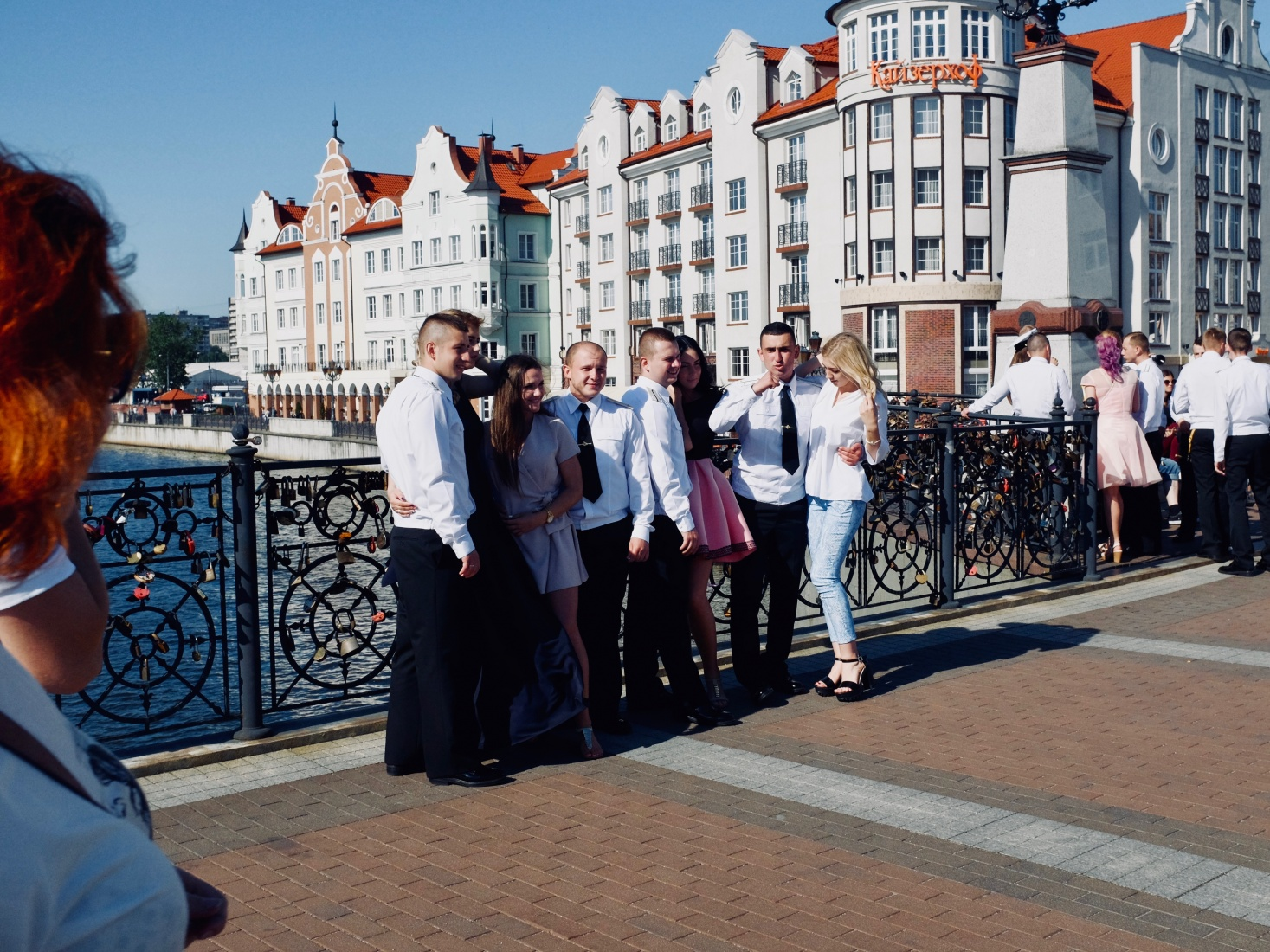 Russian sailors pose on a bridge in Fish Village in Kaliningrad, Russia, over the Pregolya River.