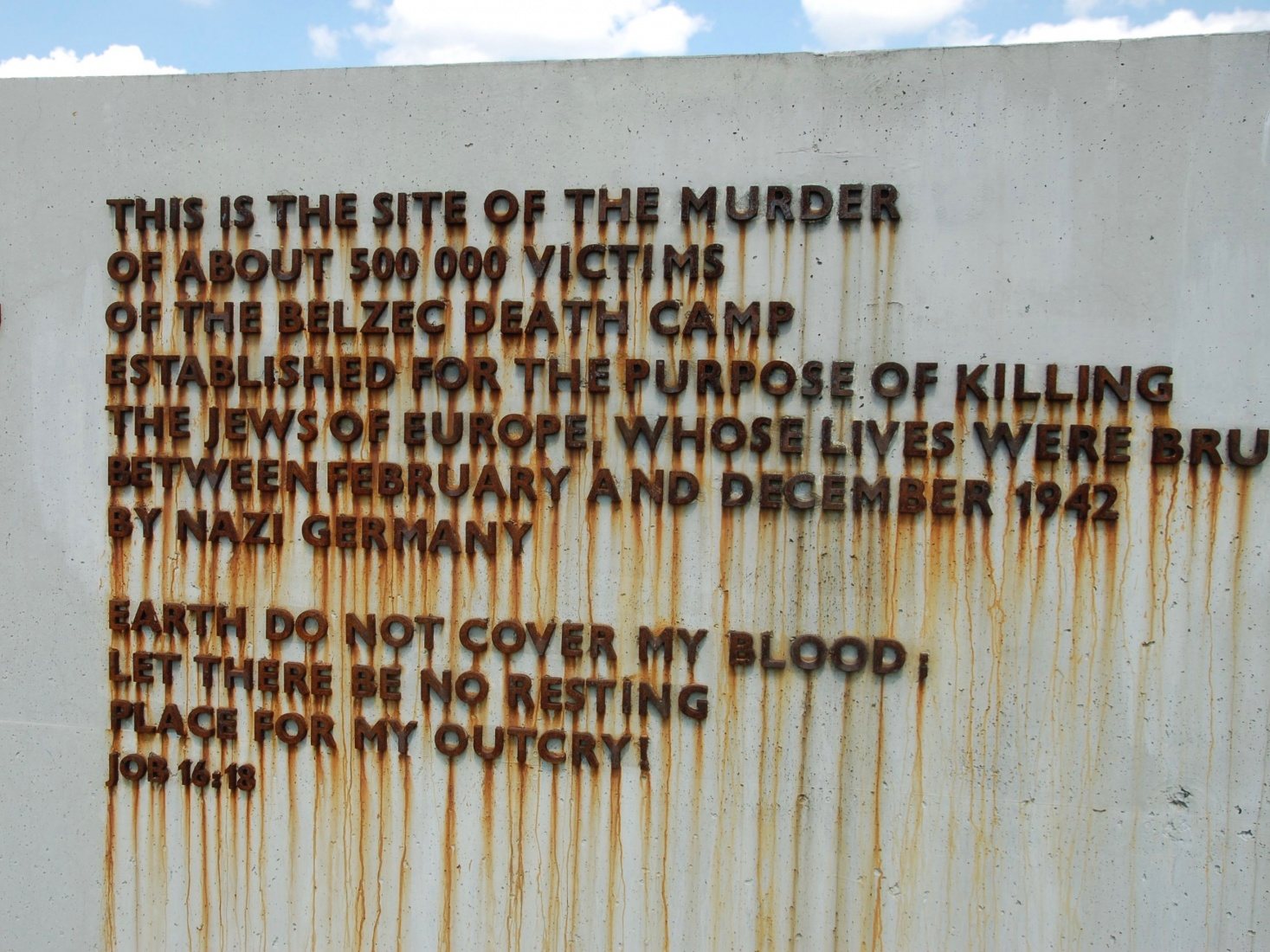 Sign and poem detailing the atrocities committed at Nazi run Bełżec extermination camp in southeastern Poland, between Zamosc and Lviv.