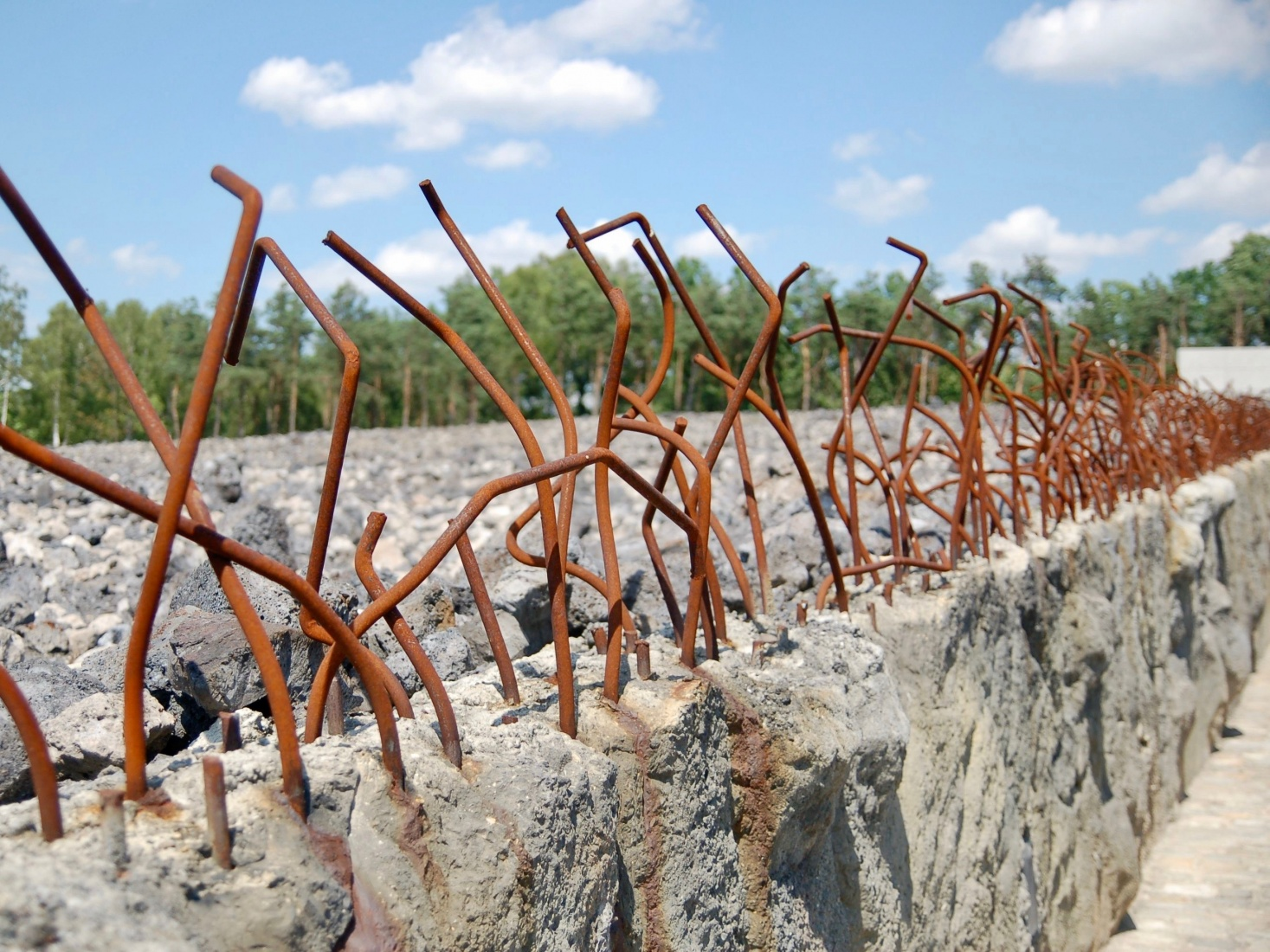 Rusting supports jutting through concrete at the Bełżec extermination camp in Poland.