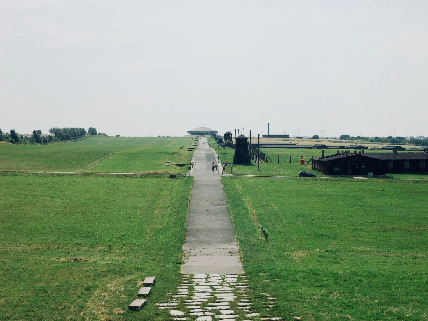 A road through the immense Majdanek concentration camp, in the distance a Victor Tolkin (Wiktor Tołkin) memorial, an urn holding the ashes of the victims, at Majdanek, outside Lublin, Poland.