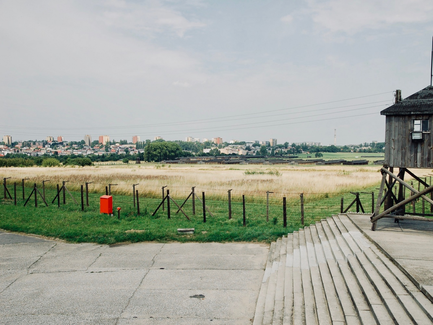 The outskirts of the city of Lublin, Poland, distantly visible from inside the Majdanek concentration camp.