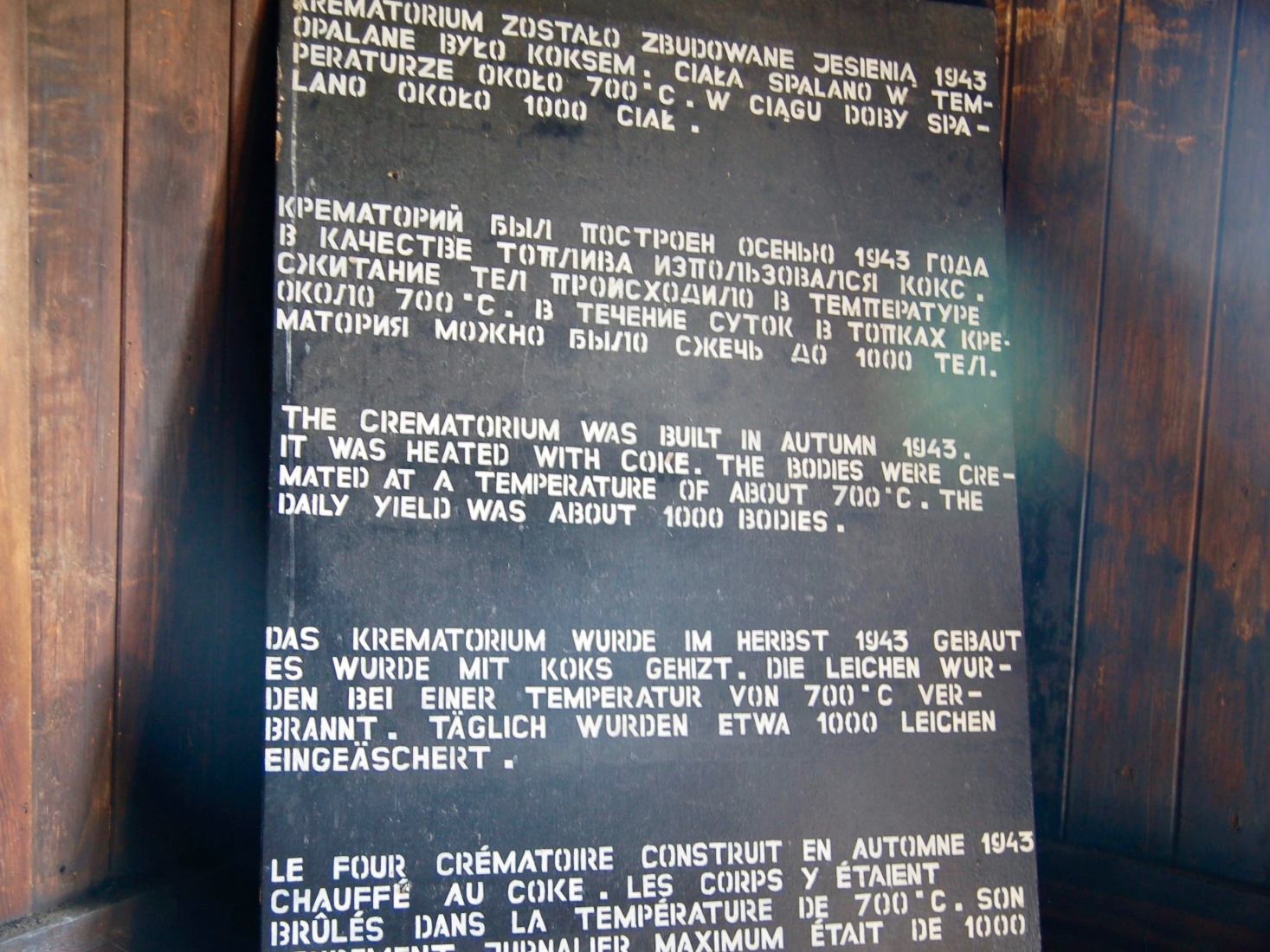 A sign at the Majdanek concentration and extermination camp detailing the history of the crematorium in 5 languages. Outside Lublin, Poland.