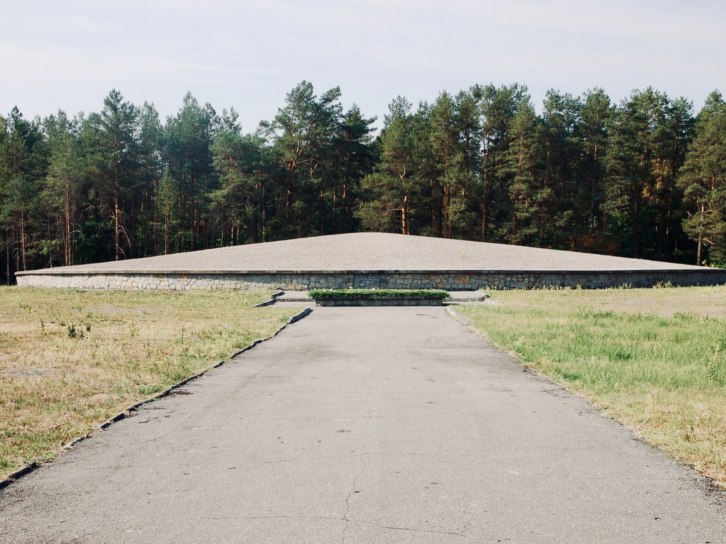 A large flying saucer-looking monument covers a giant mound of victims ashes at the Sobibór death camp in the middle of the Polish forest, near the country's boarder with Ukraine.