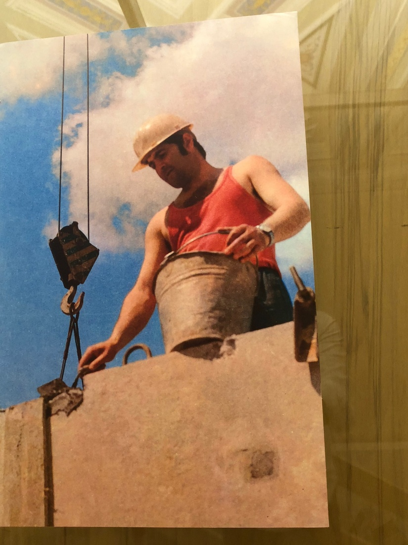 A photo of a construction worker building new apartment blocks in the Communist era of the Czech Republic.