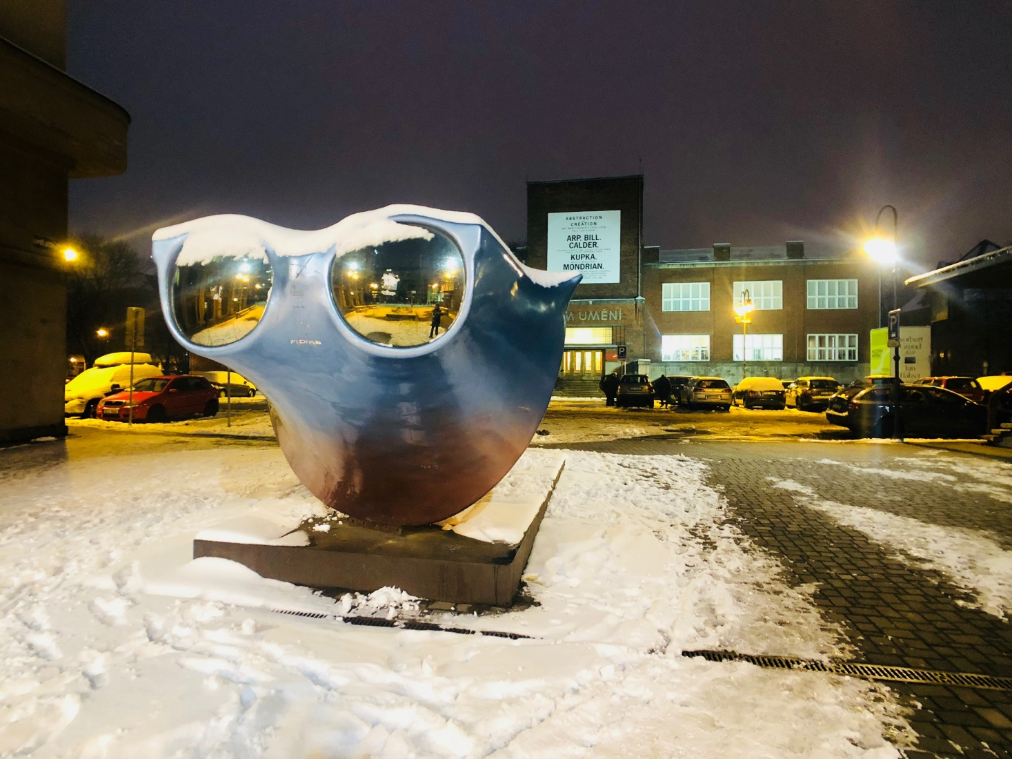 An artsy square with a large sculpture resembling Ray Ban sunglasses outside the House of Art and next to the former Cafe Elektra, now J&T Banka Café, in Ostrava, Czech Republic.