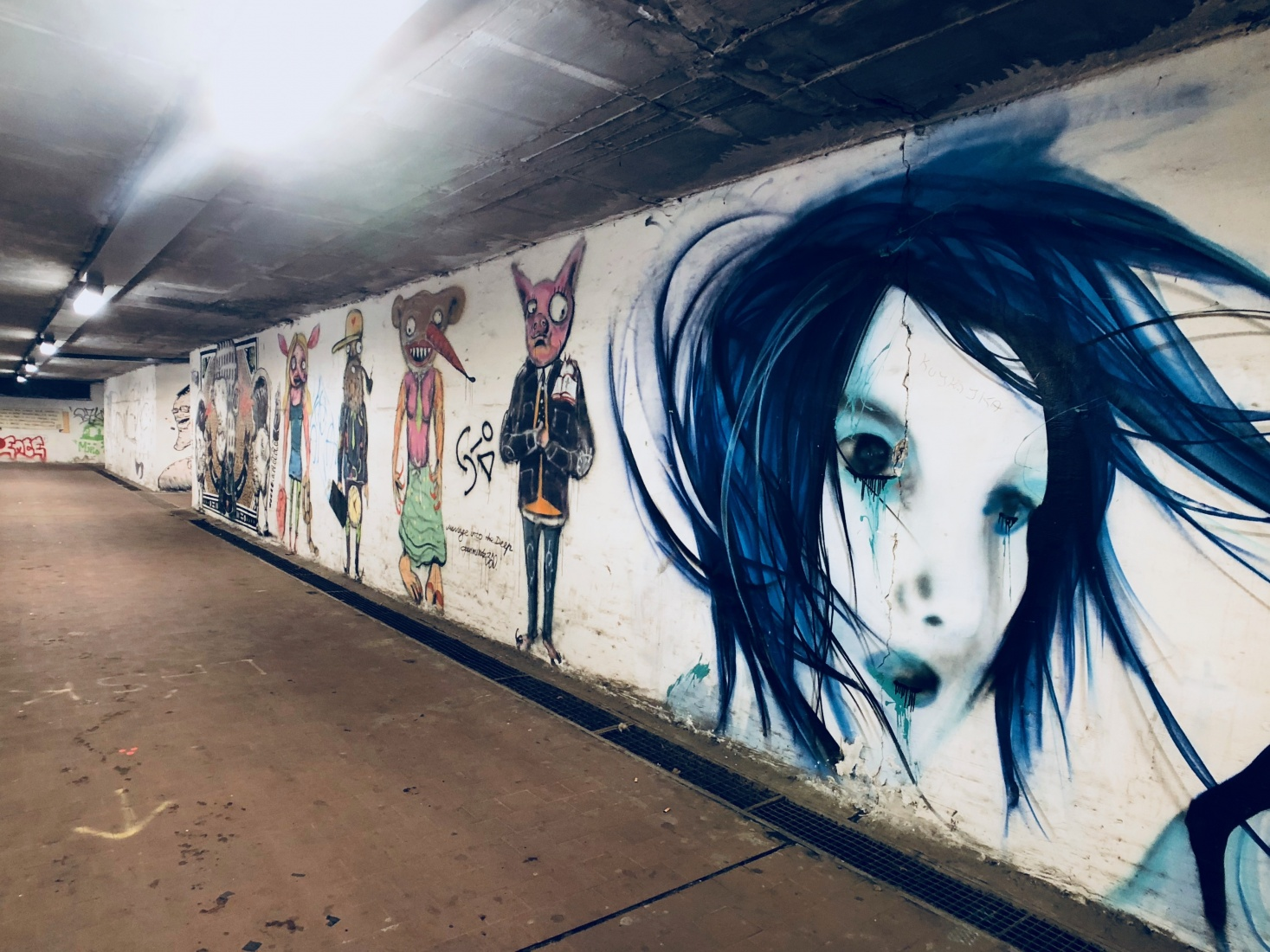 Street art on the underground passage walls leading from the tram stop to the Dolní Vítkovice steelworks in Ostrava, Czech Republic.