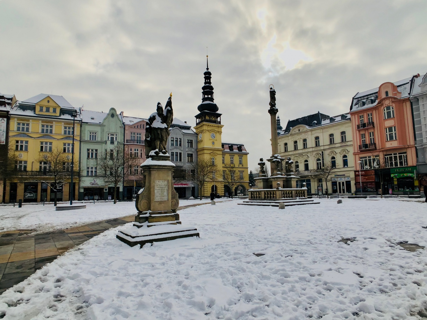 Tiny Old Town in Ostrava, Czech Republic, with interesting architecture, spires, and several statues.