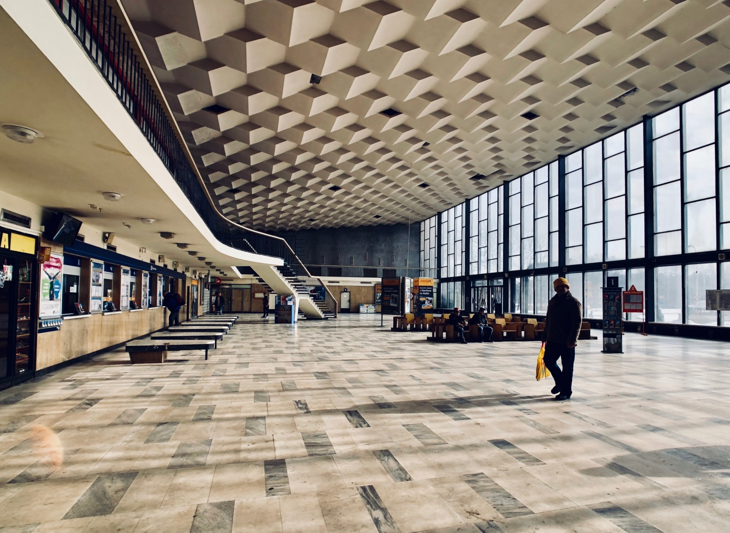 The train station main vestibule, with geometric floor and ceiling patterns, in the Czech-Silesian mining city of Havířov, Czech Republic.