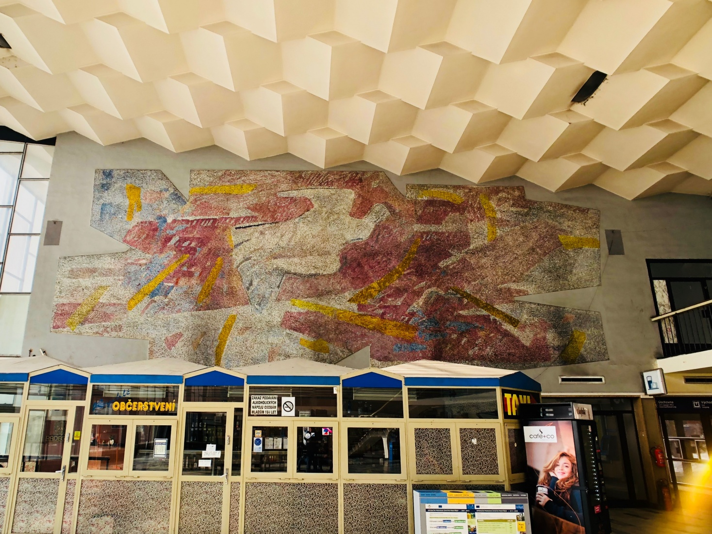One wall in the train station, dominated by a colorful glass mosaic designed by Czech artist Vladimir Kopecký, in the Czech-Silesian mining city of Havířov, Czech Republic.