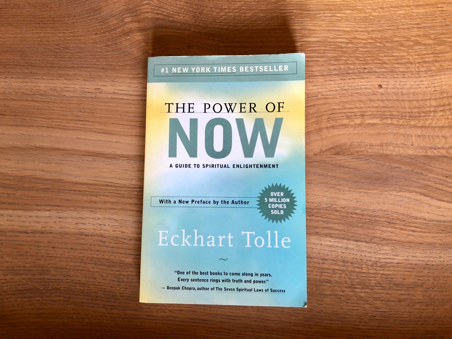 Cover of Eckhart Tolle book The Power of Now, 1997, a popular and influential book about mindfulness that distinguishes between ego and being as a way to understand behavior.