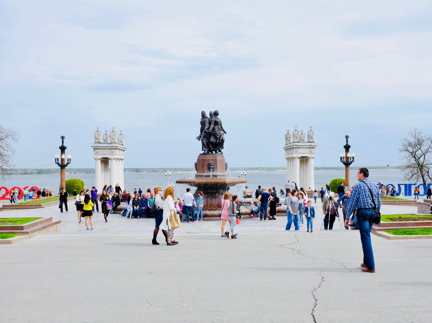 Statues, waterfront, and locals at the riverfront promenade in Volgograd, Russia.