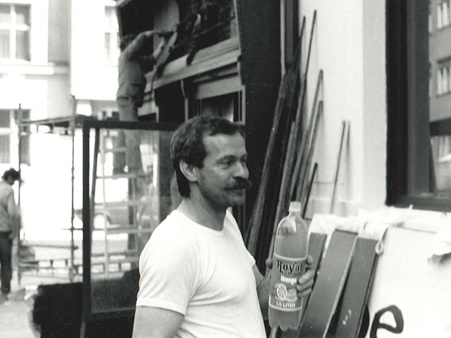 Head of the reconstruction team Honza Král, during renovations before the opening of The Globe Bookstore and Coffeehouse in Holešovice, Prague. 1993.