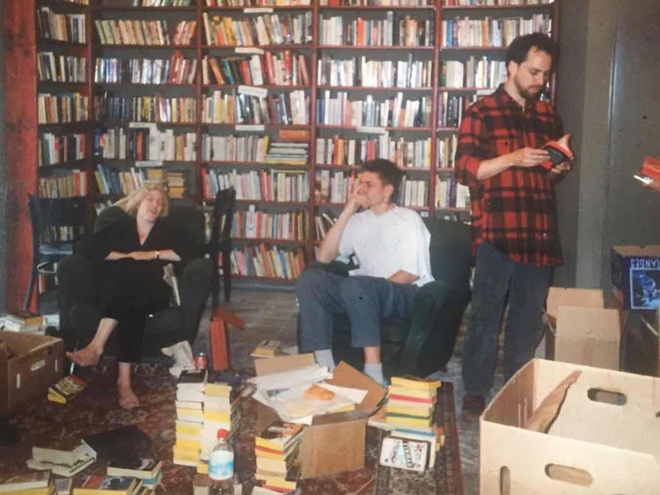 Mark Baker and Jenny Becker among the bookshelves, shelving books before opening, at The Globe Bookstore and Coffeehouse in Holešovice, Prague, early July 1993. Photo courtesy of Scott and Markéta Rogers.