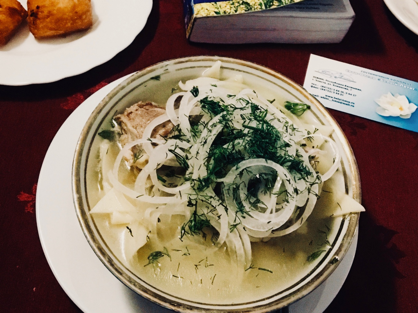 Kalmyk meal hasn makhn, slices of mutton-muscle, served on pasta and covered in onion. In Elista, Russia.