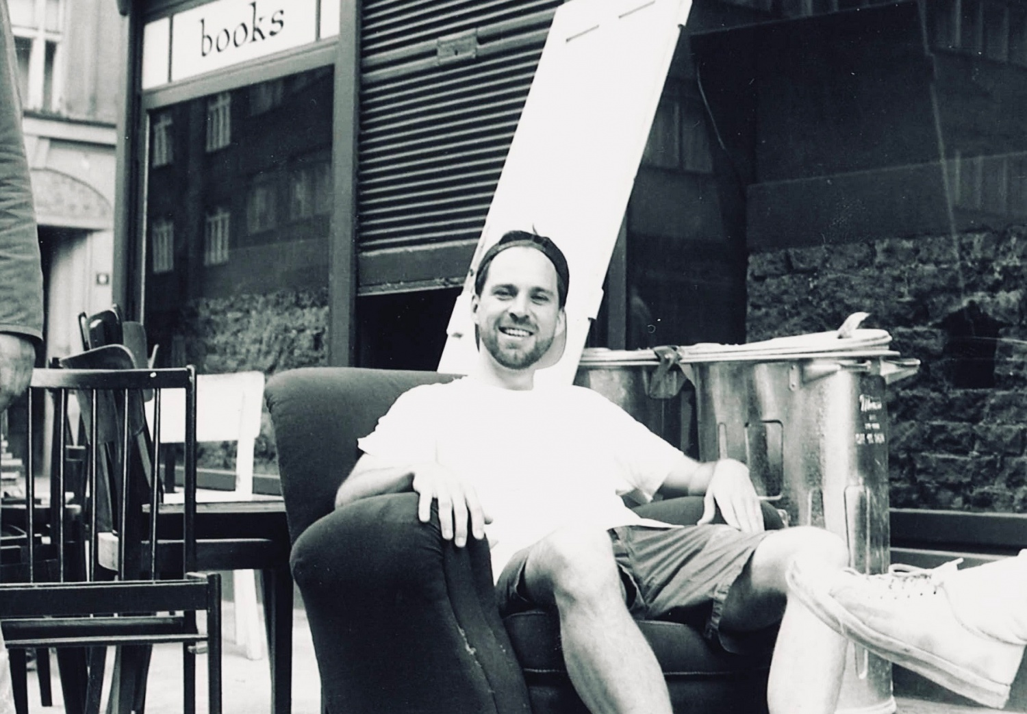 Mark Baker in front of The Globe Bookstore and Coffeehouse at a work party before store opening in June 1993, Holešovice, Prague.