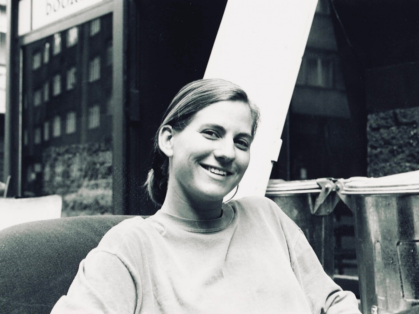 Markéta Rogers smiling at the camera, taking a break from working on store renovations at The Globe Bookstore and Coffeehouse in late spring, 1993, Holešovice, Prague.