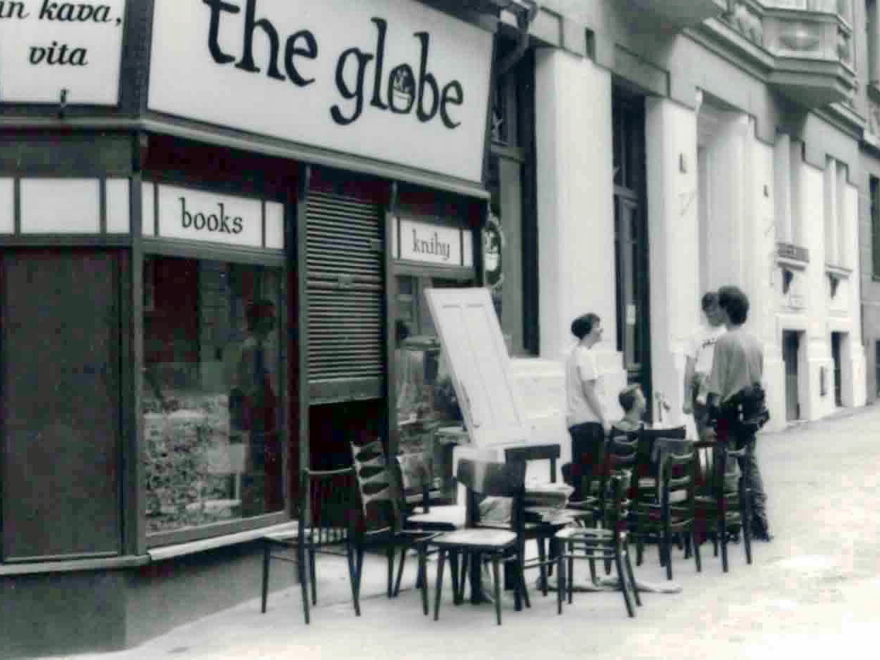 The store front of The Globe Bookstore and Coffeehouse shortly before opening in 1993. Maura Griffin and Jasper Bear in the background. Holešovice, Prague.