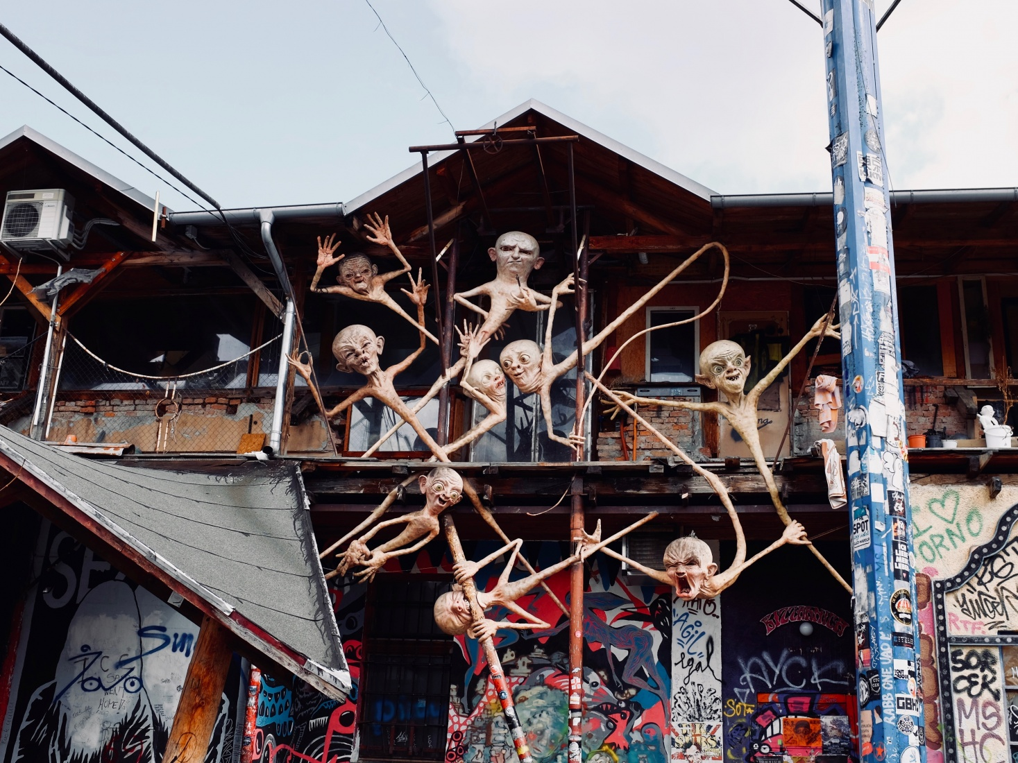 Demon statues among graffiti at Metelkova Mesto squat, in abandoned military barracks, popular with students and youth in Ljubljana, Slovenia.