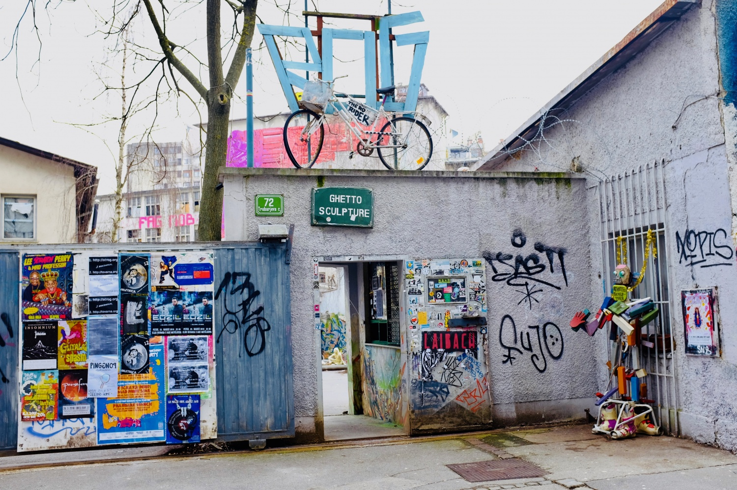 Exterior entrance to Rog squat, in an abandoned former bicycle factory, with Rog written in the bike over the door, covered in graffiti by students and local youth, in Ljubljana, Slovenia.