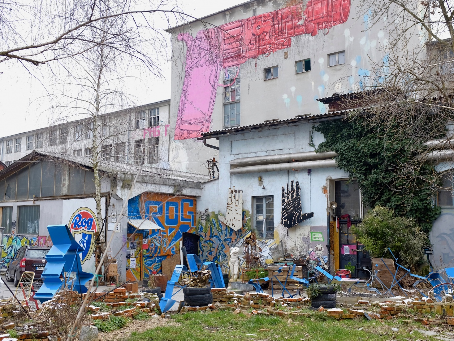 Graffiti, statues, and assorted street art at the Rog squat, popular with the student and youth populations in Ljubljana, Slovenia.