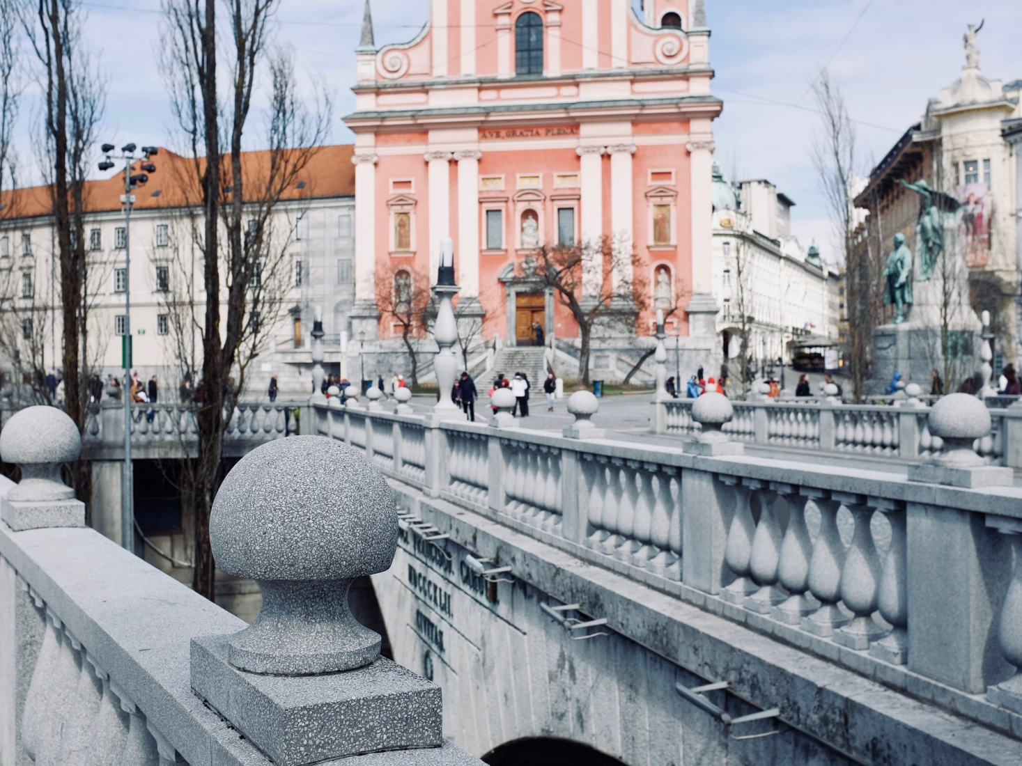 Triple Bridge in Ljubljana, Slovenia, designed by Jože Plečnik showing equal parts beauty and use, with a classical looking architecture design over the Ljubljanica River.