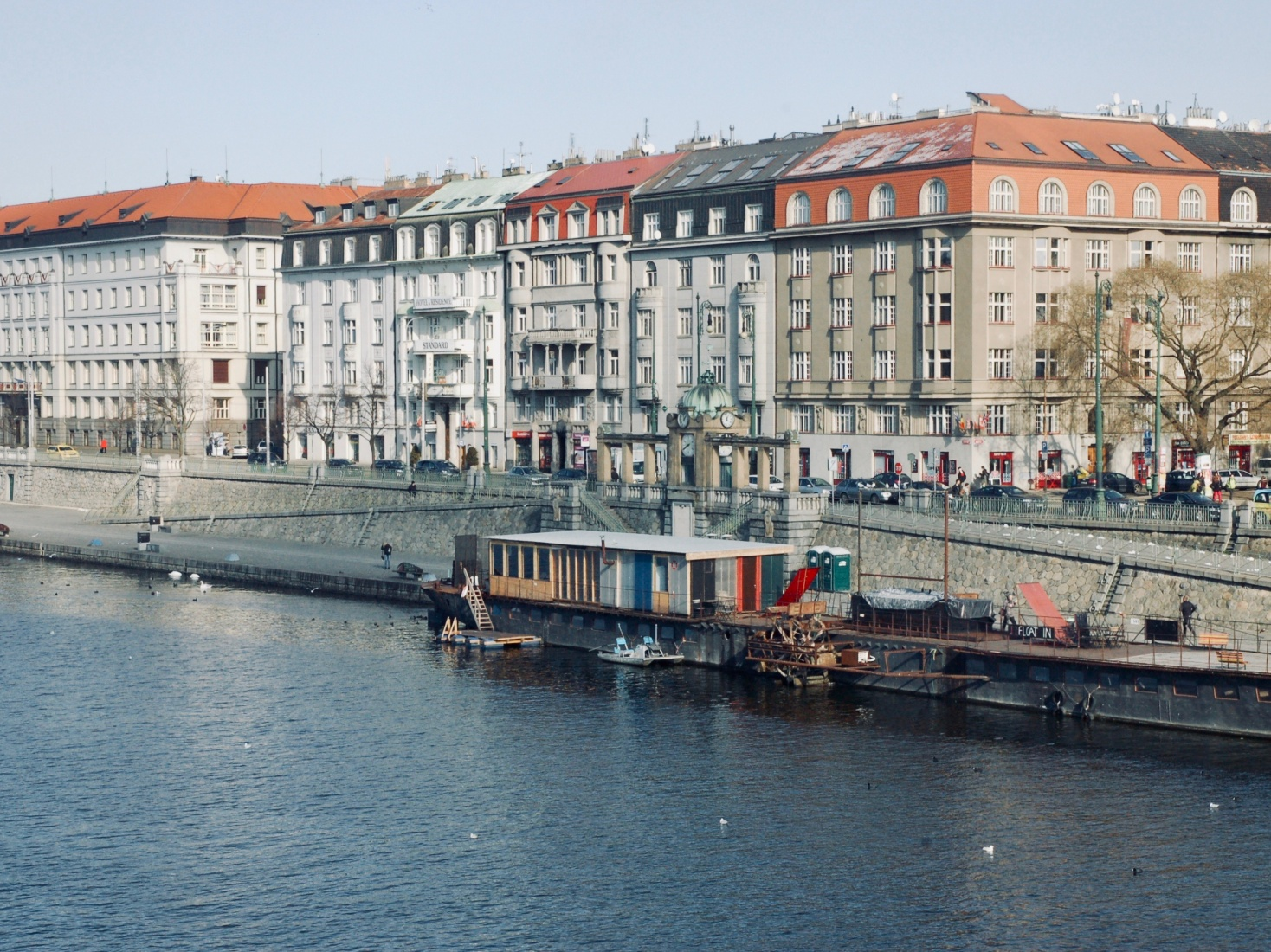 Neoclassical architecture in townhouses along the Vltava River in Prague, built in the 19th century.