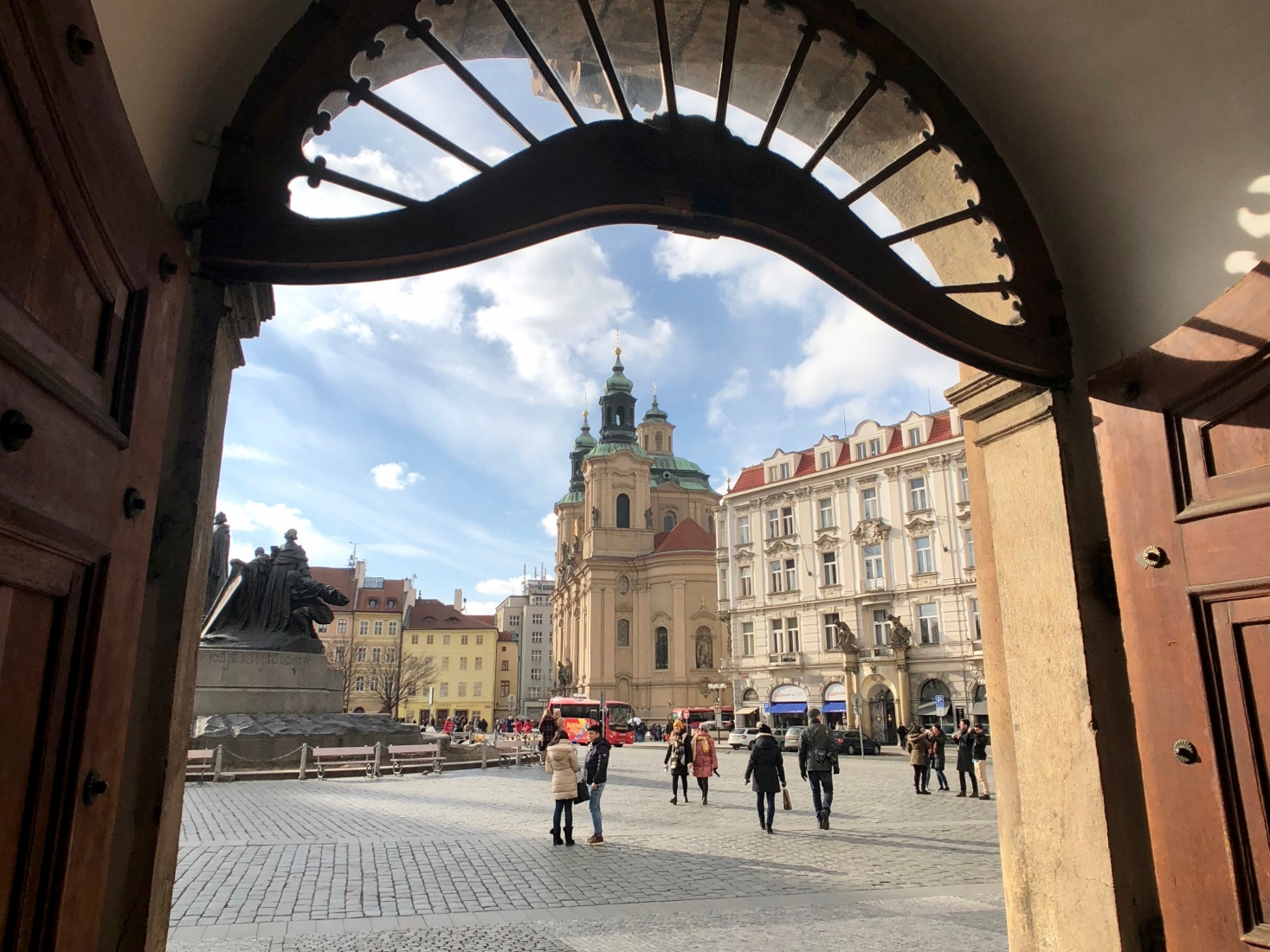 Old Town Square in Prague, with Baroque Church of St. Nicholas surrounded by Neo-Classical and other architecture.