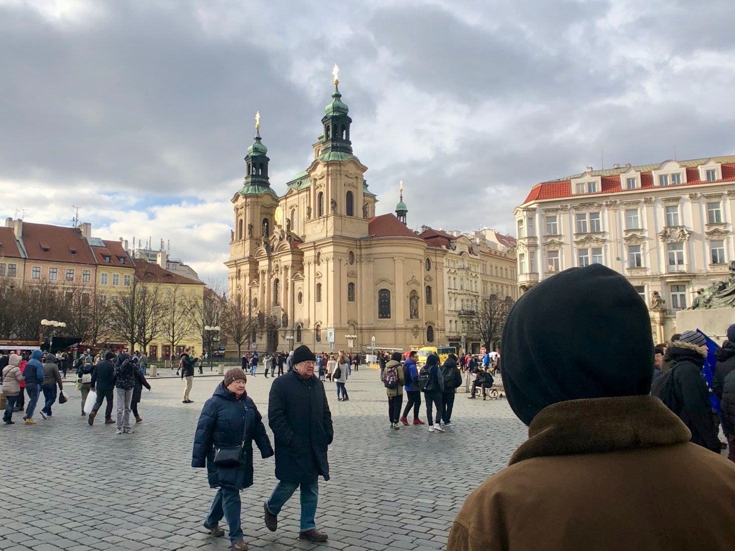 Baroque St. Nicholas Church in Old Town Square, Staromestska, Prague, surrounded by neoclassical and other eras of architecture.