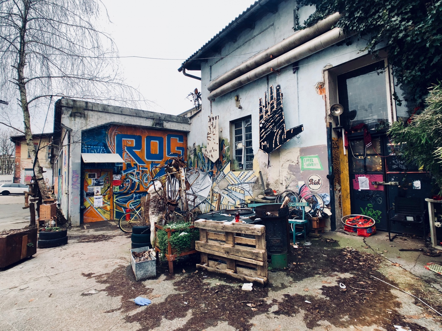 Graffiti-covered walls, statues, and art pieces at Rog squat, Metelkova Mesto squat's younger counterpart in a former bicycle factory, in Ljubljana, Slovenia.