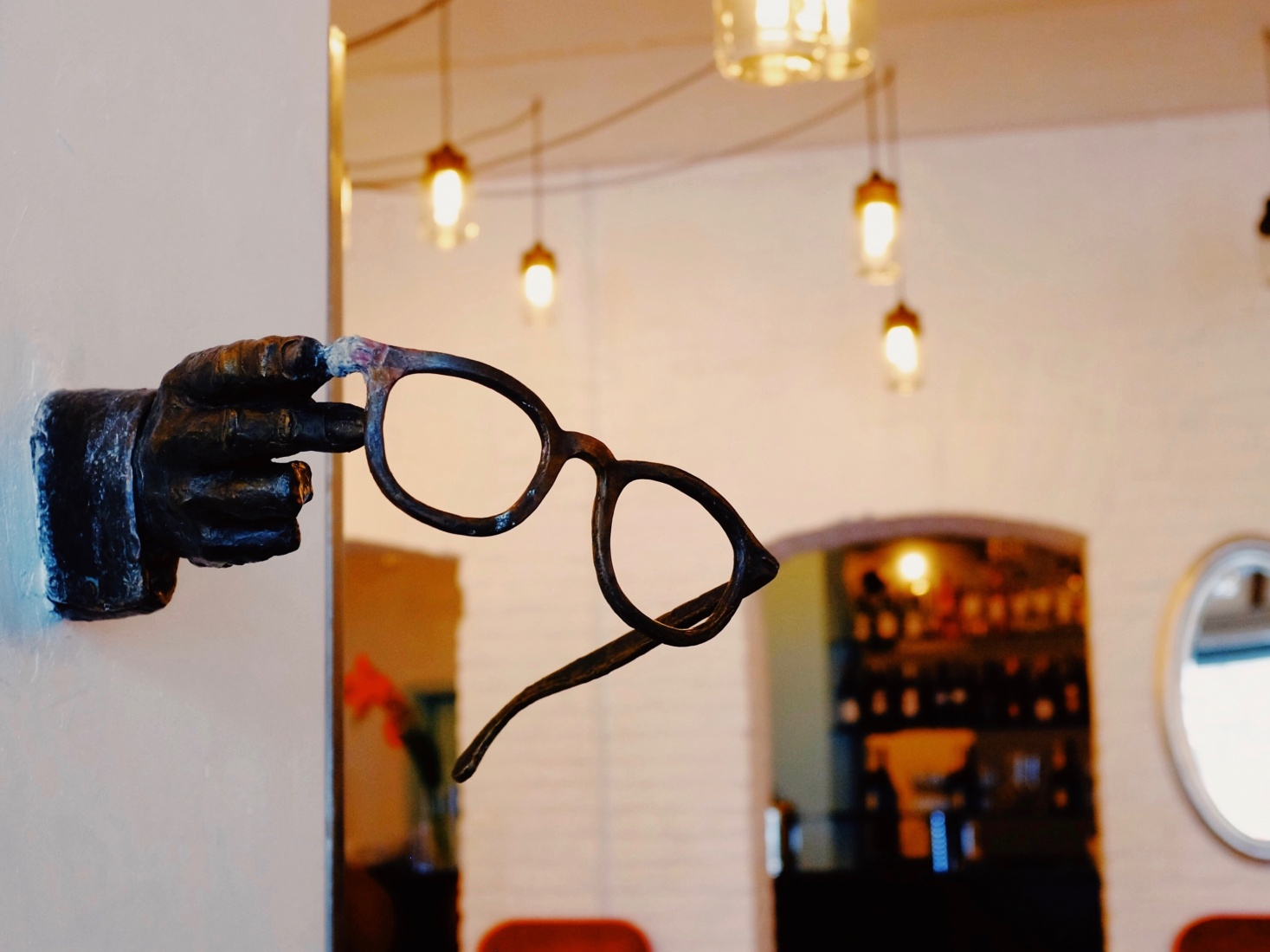 A statue monument of famous film director Woody Allen with hand and iconic glasses mounted on the wall of a downtown cinema in Kaliningrad, Russia. Allen was born Allan Stewart Konigsberg.