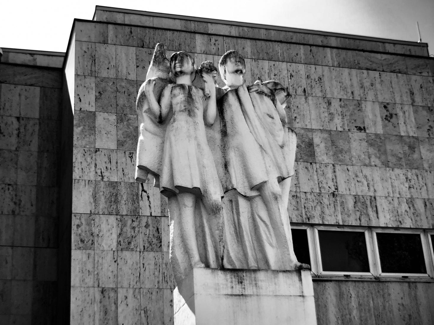 Communist era statue in front of Russian school in Prague, Bubeneč, with typical communist era architecture behind, near Siberia Square,  Sibiřské náměstí.