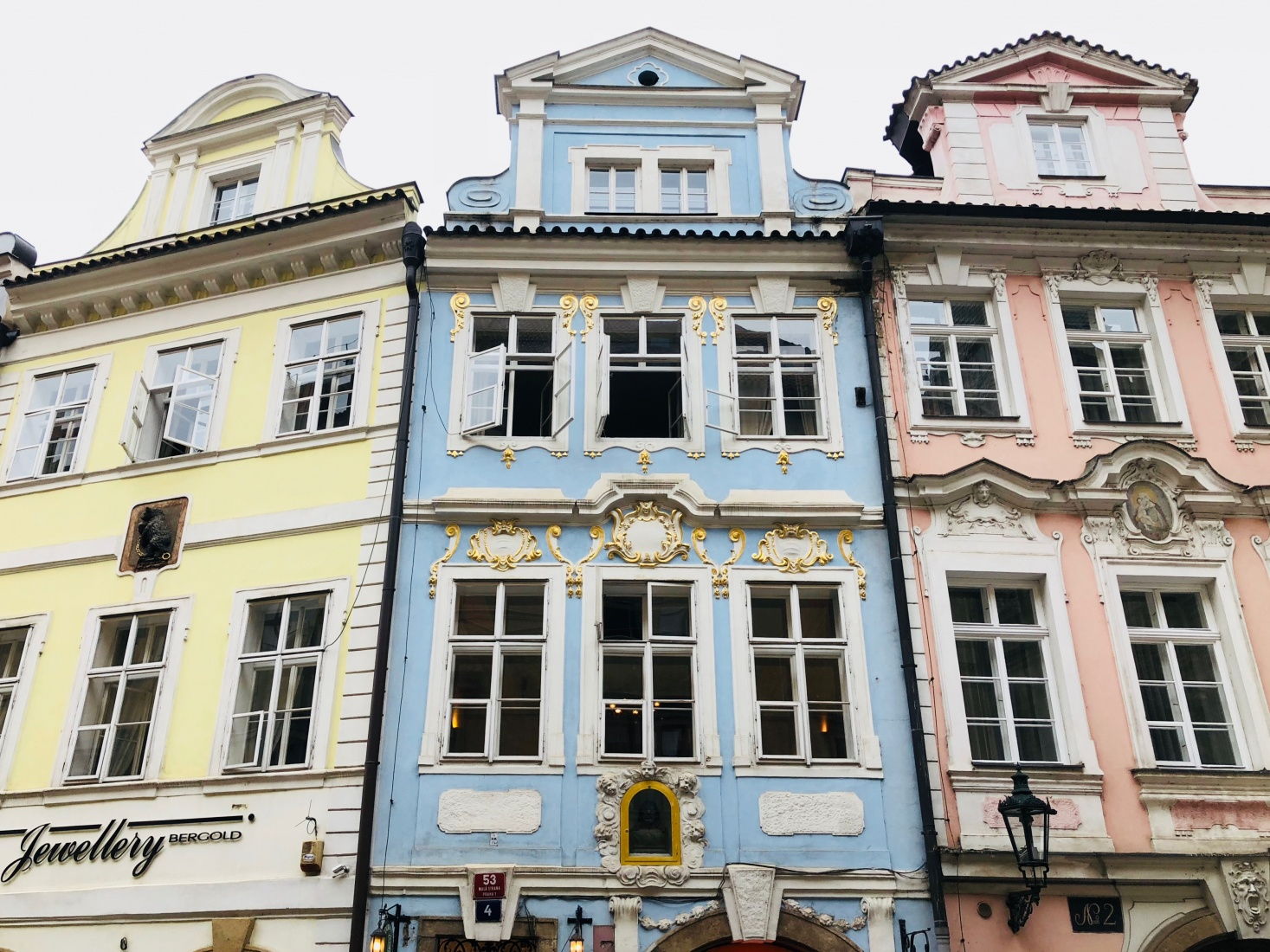 Colorful Baroque townhouse facades in Malá Strana, Prague Lesser Town, on the street that leads to Charles Bridge.