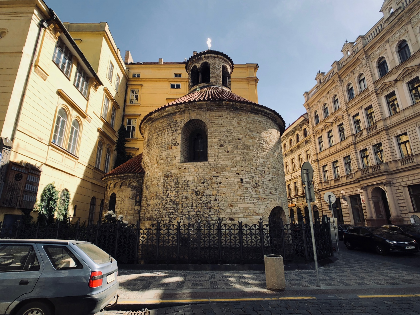 Romanesque Rotunda of the Holy Cross in Prague, near the National Theater, surrounded by 19c Neo-Classical housing.