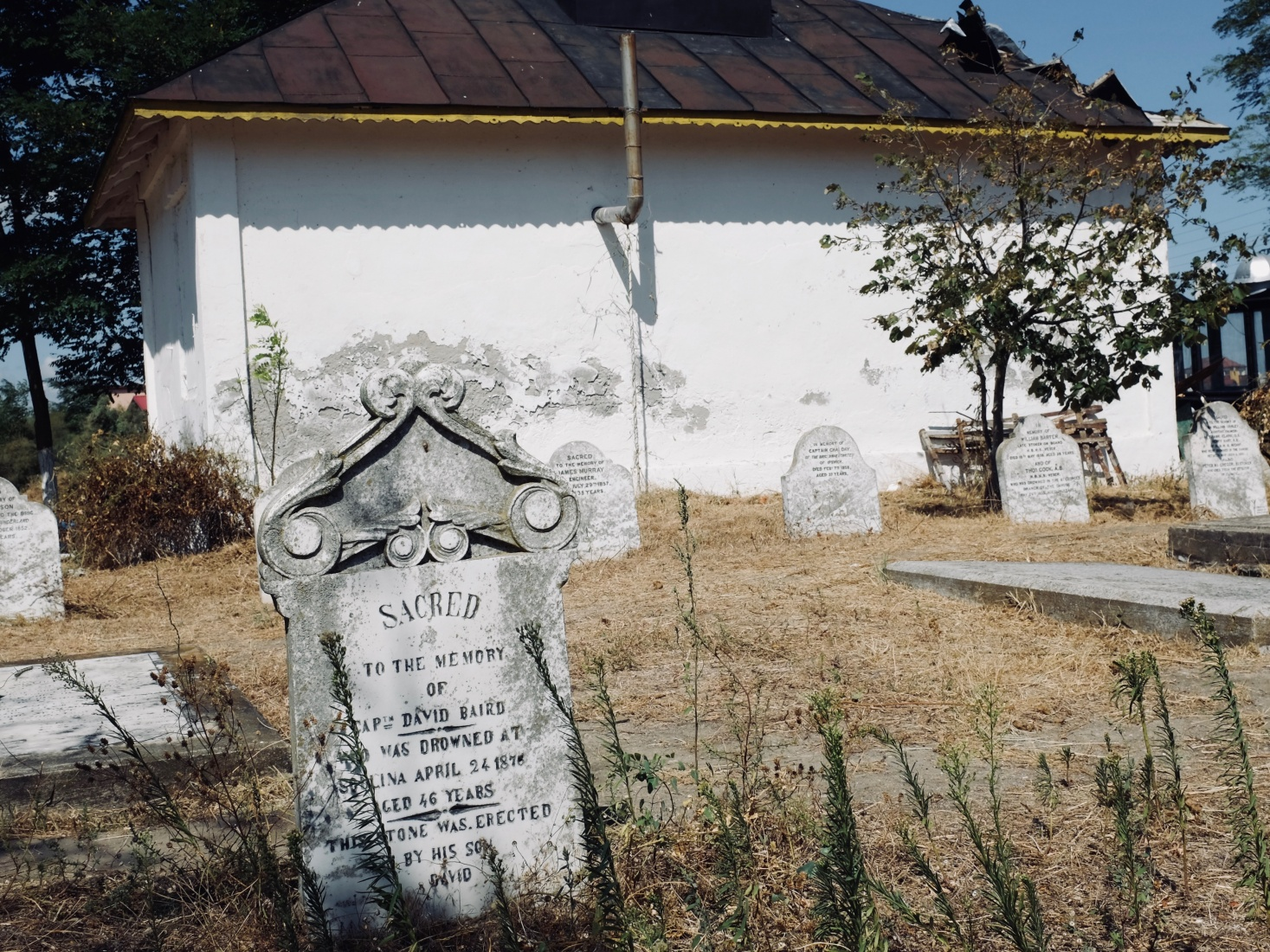The tombstone of David Baird, a worker who died trying to open up the channels of the Danube to commericial boats near Sulina, Romania in the 19th century.