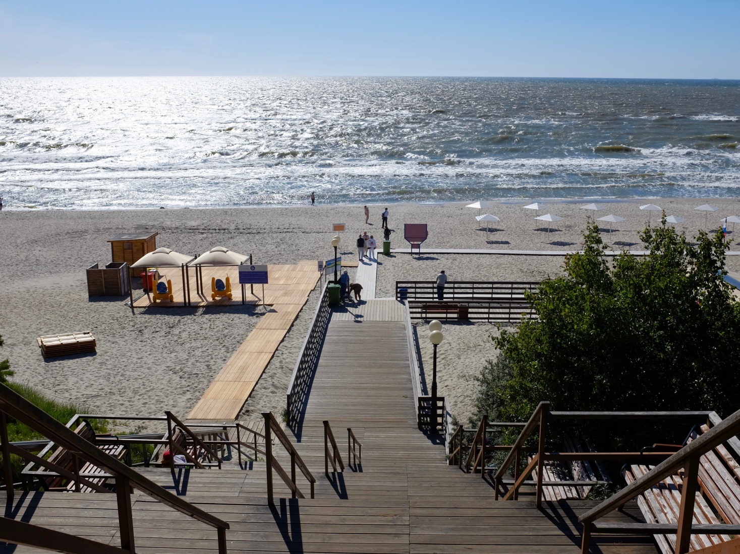 Wooden steps leading down from central Becker Part to Yantarny public beach, outside Kaliningrad, Russia.