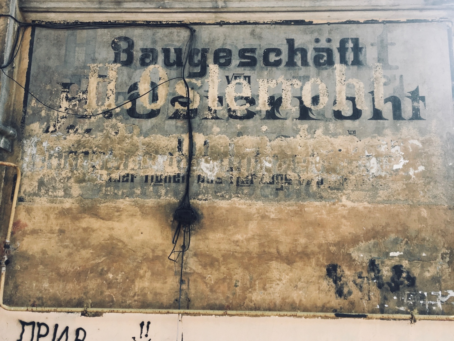 An old surviving German sign on the side of a building in the inland city of Chernyakhovsk, outside Kaliningrad, Russia.