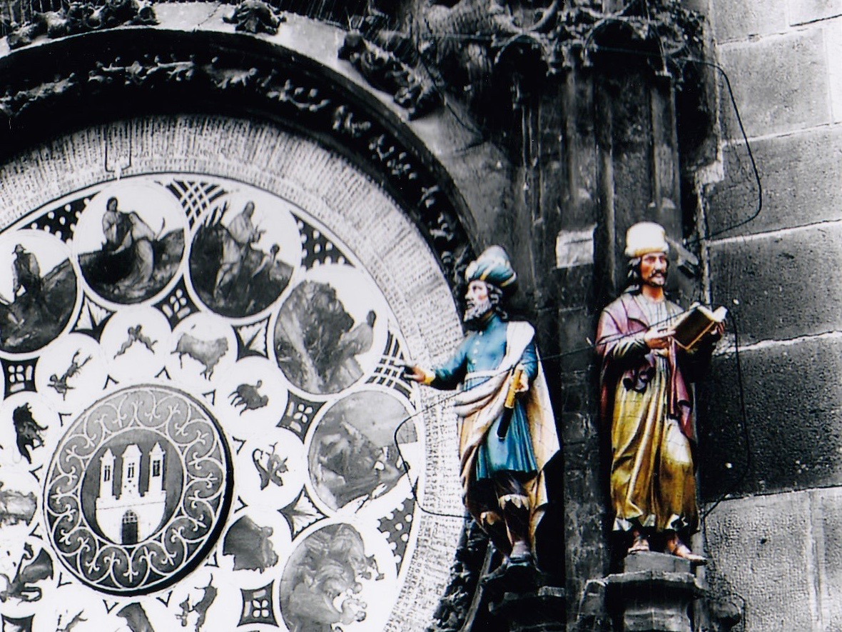 Prague's Astronomical Clock, which was a surprisingly sophisticated scientific instrument for its time, with statues of men, possibly scientists, on the side.