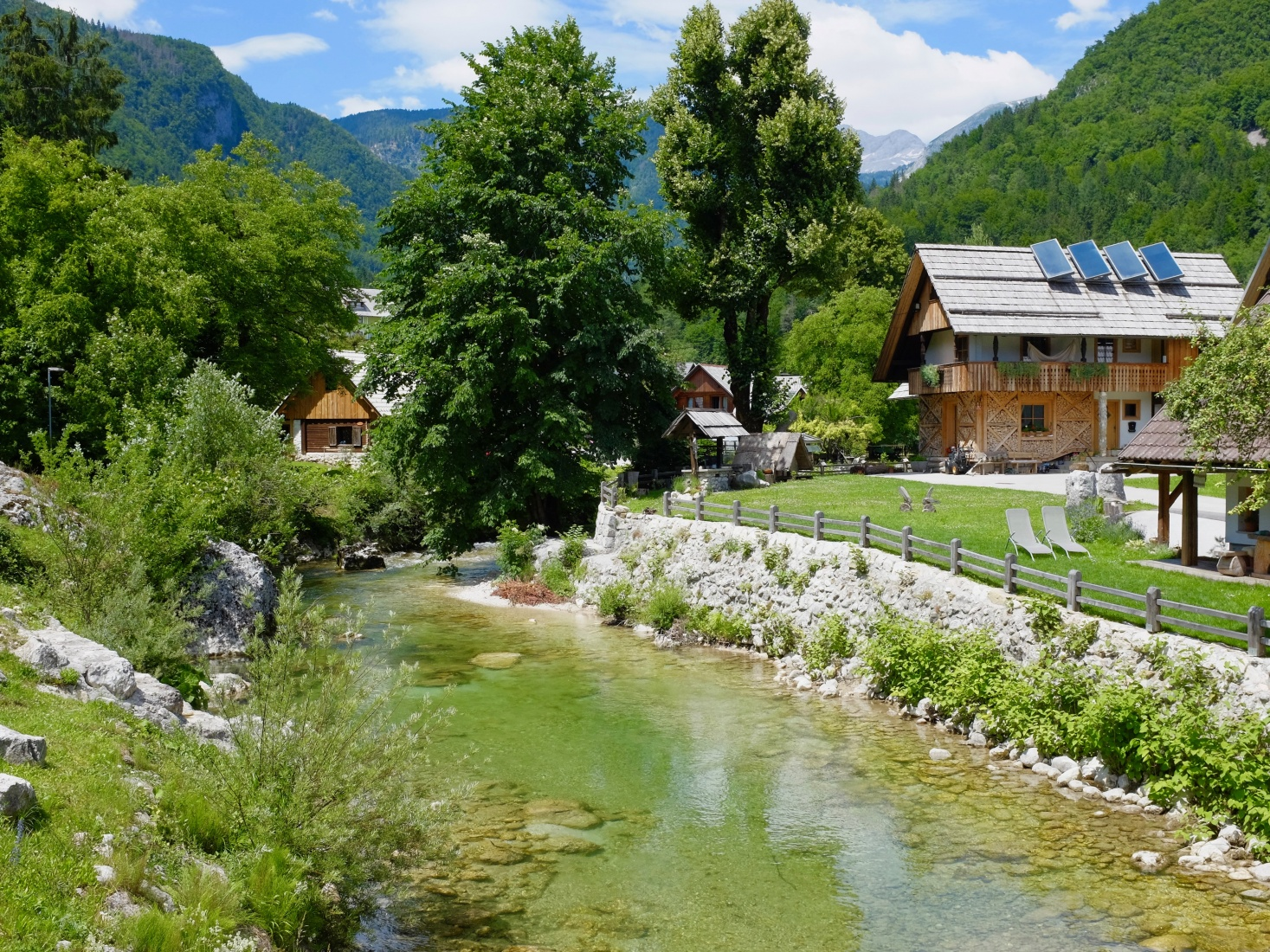 A small village along the water in the Slovenian mountains.