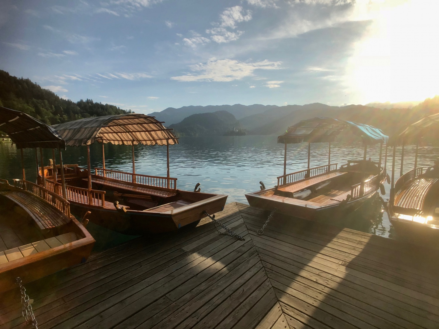 Gondolas at sunset on Lake Bled, Slovenia. They are the most popular way to get to Bled Island.
