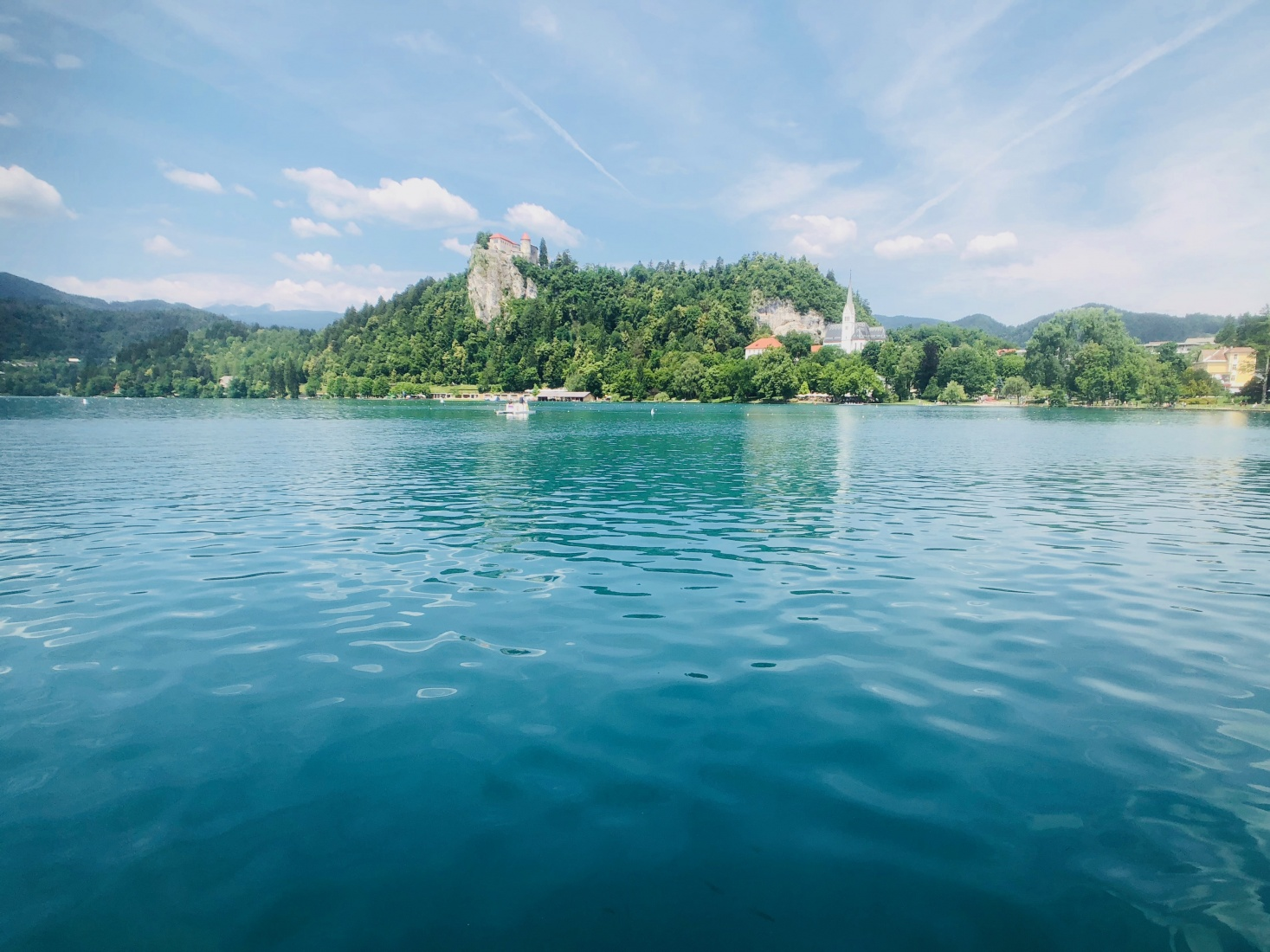 View of Bled Castle over the blue green waters of Lake Bled, Slovenia.