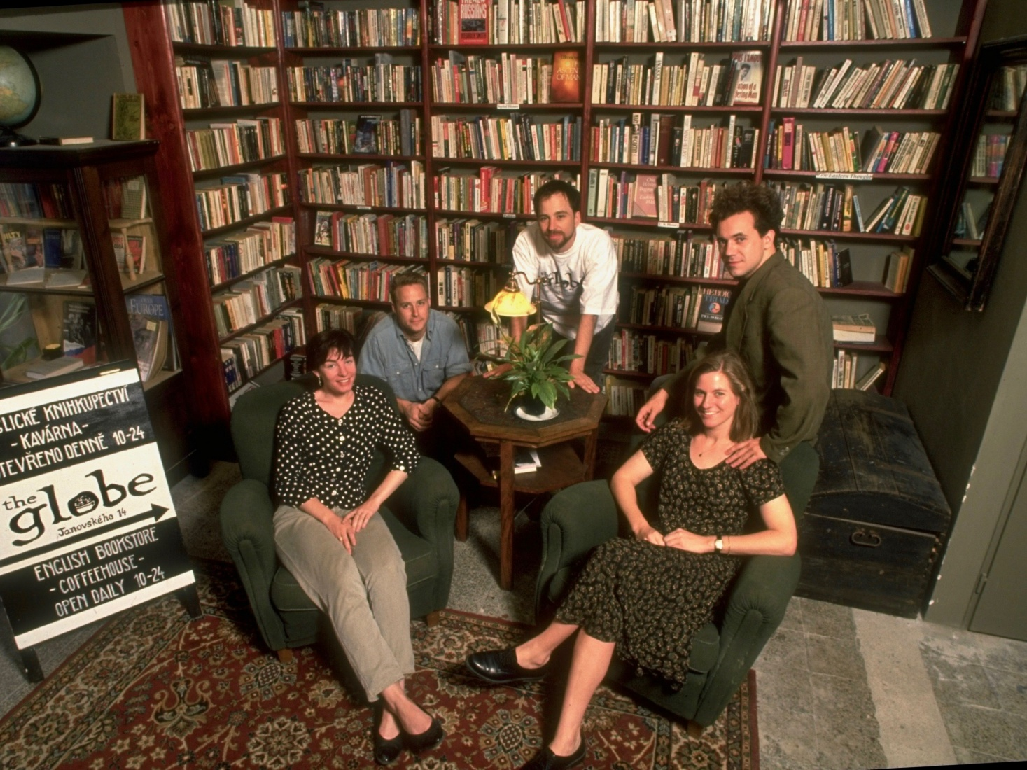 The five original partners, pictured here sometime shortly after opening in July 1993 (from right to left): Markéta Janků, Scott Rogers, Mark Baker, Jasper Bear and Maura Griffin, in the Globe Bookstore in Holešovice, Prague, Czech Republic.