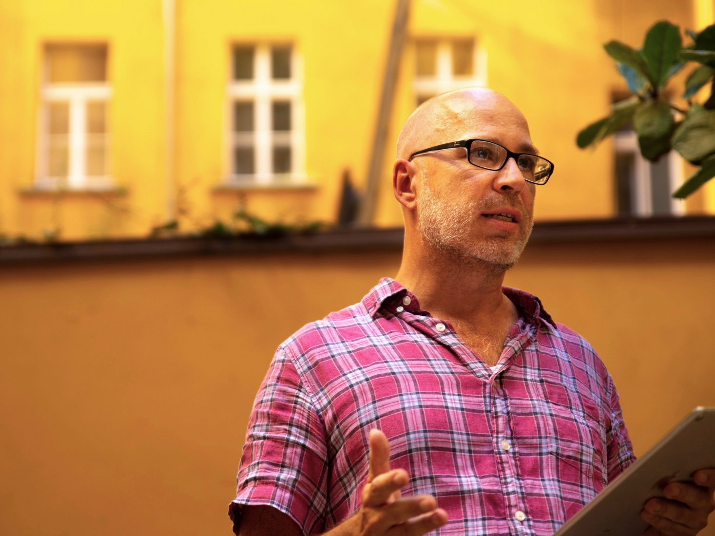 Mark Baker talking about the old days at the Globe's 25th anniversary party in July 2018; in Prague, Czech Republic.