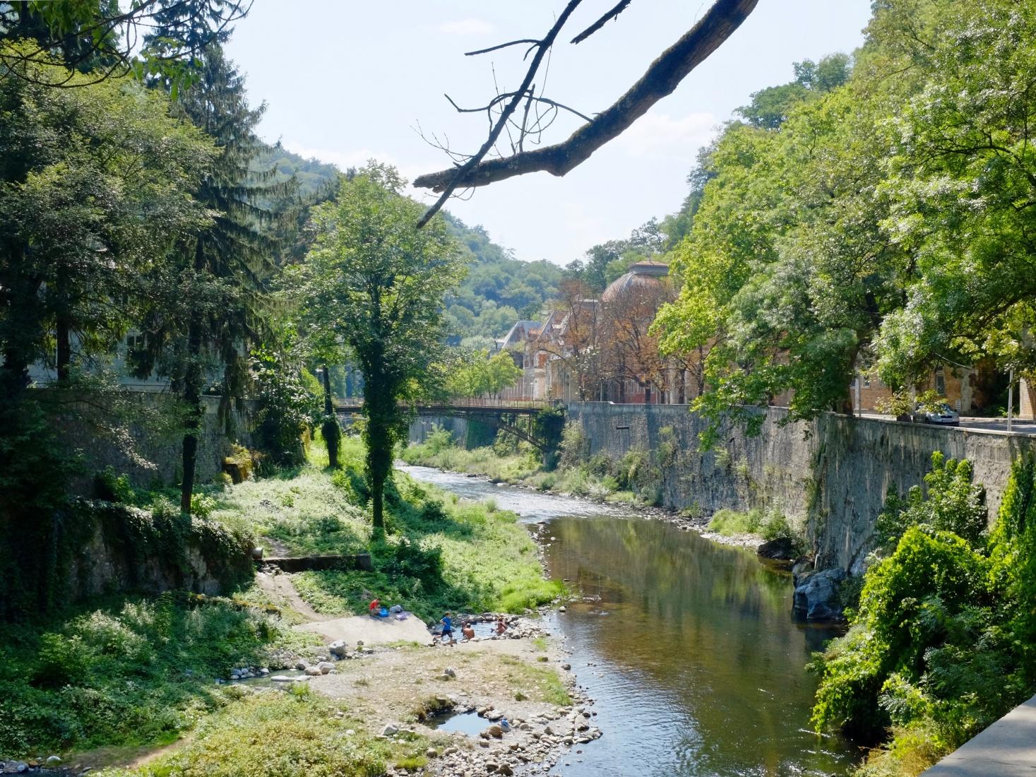 A view of the beautiful Cerna River near the Baths of Hercules in Brașov, Romania.