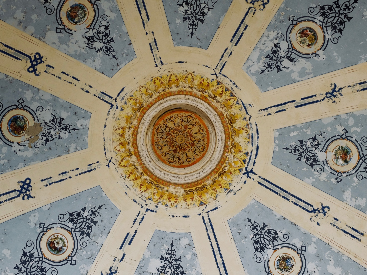 The ornate decorative paintings on the ceiling outside the historic casino building in Brașov, Romania.