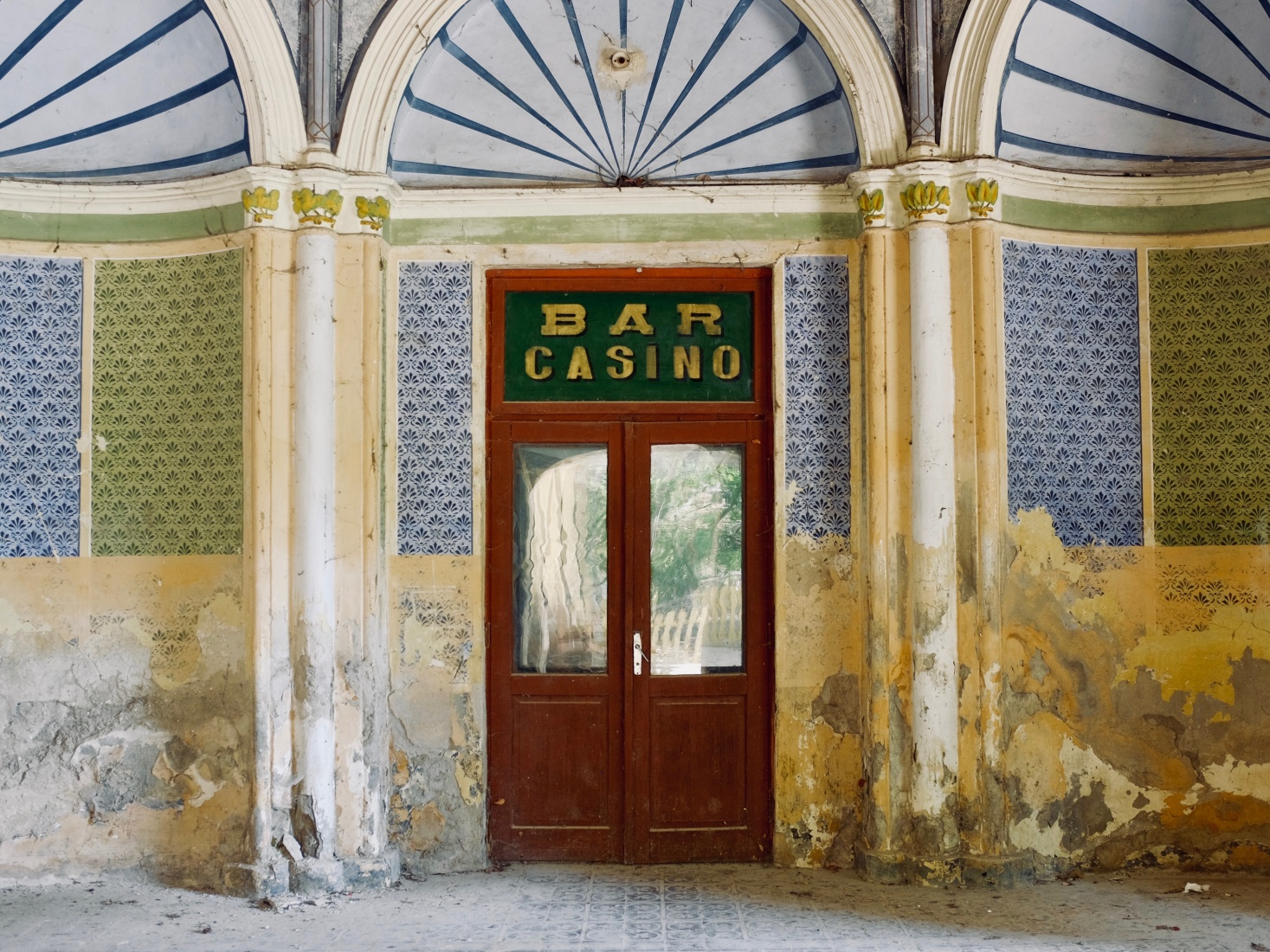 A crumbling doorway into the abandoned casino in Brașov, Romania.