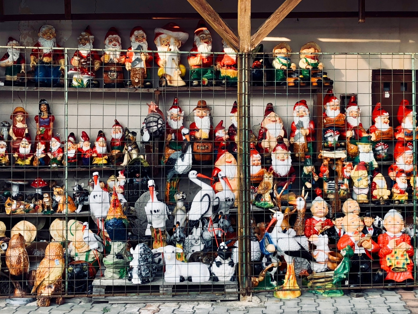 A wide assortment of garden gnomes for sale in České Velenice, Czech Republic.