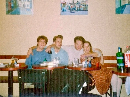 Night in the coffeehouse, sometime probably in 1994. Josh (left), Jasper, James, and Barbara, in Prague, Czech Republic.
