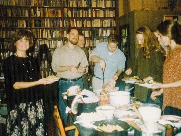 Their first Thanksgiving in November 1993: Jasper cutting the turkey; in The Globe Bookshop in Prague, Czech Republic.