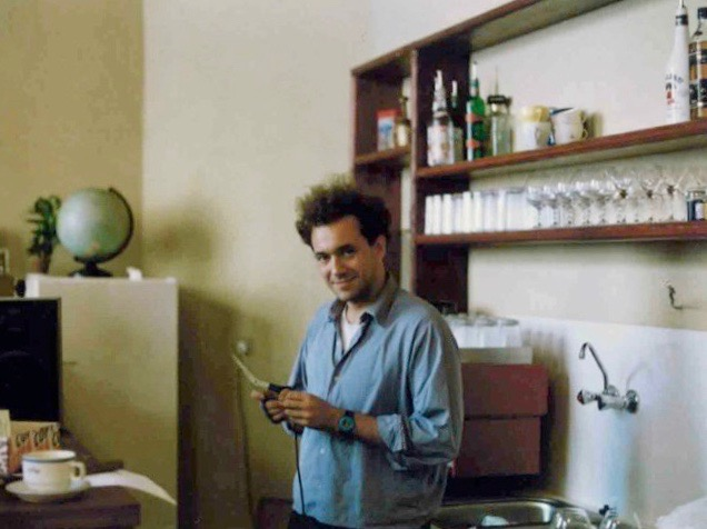 Partner Scott Rogers standing at the bar, showing off his Eraserhead hair, shortly before opening The Globe Bookshop in Prague, Czech Republic, in July 1993.