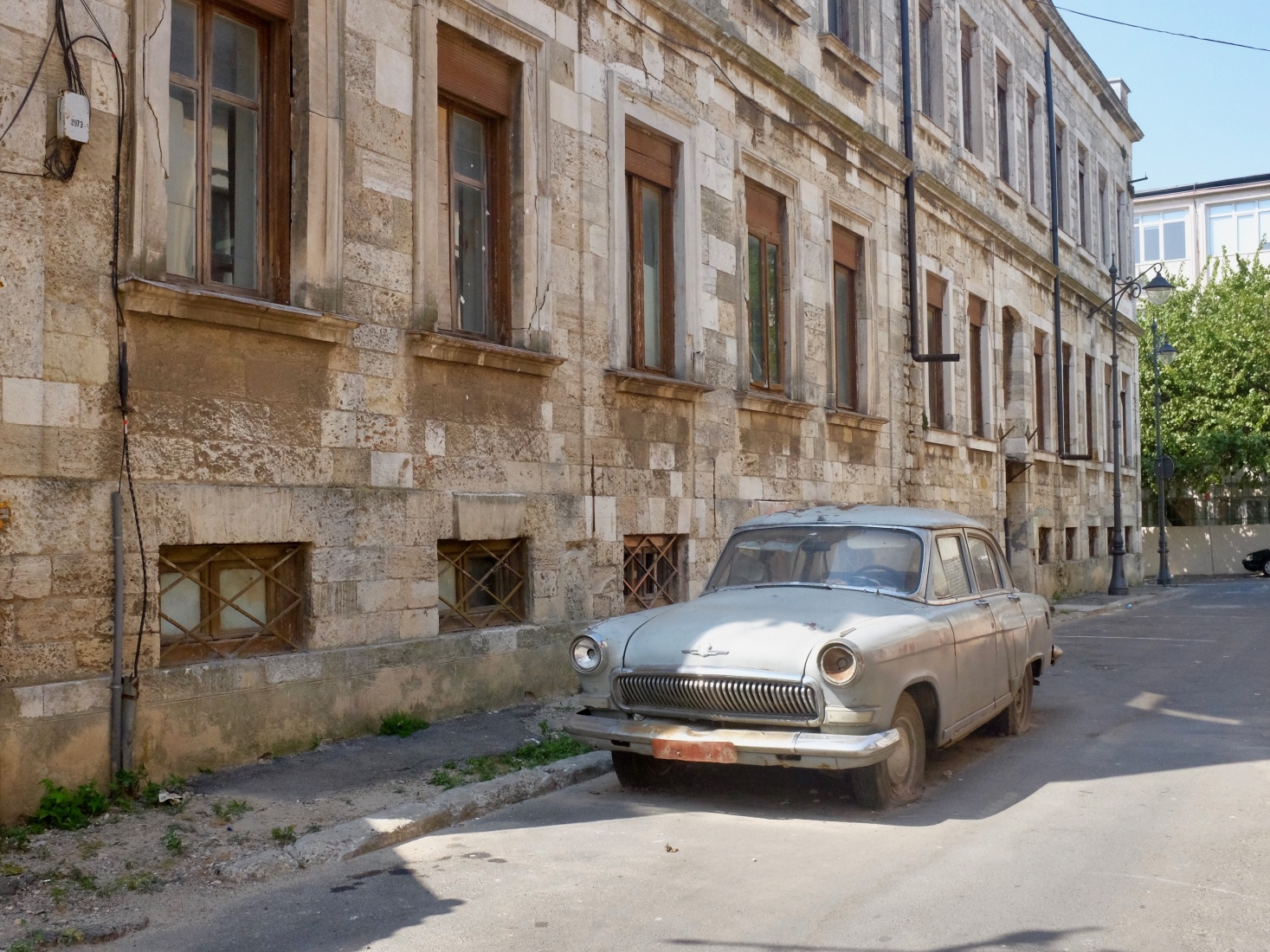 An old car and empty street near the old port in Constanța, Romania.